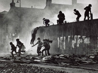 Catholic youth escaping a CS gas assault in the Bogside, Londonderry, Northern Ireland, 1971